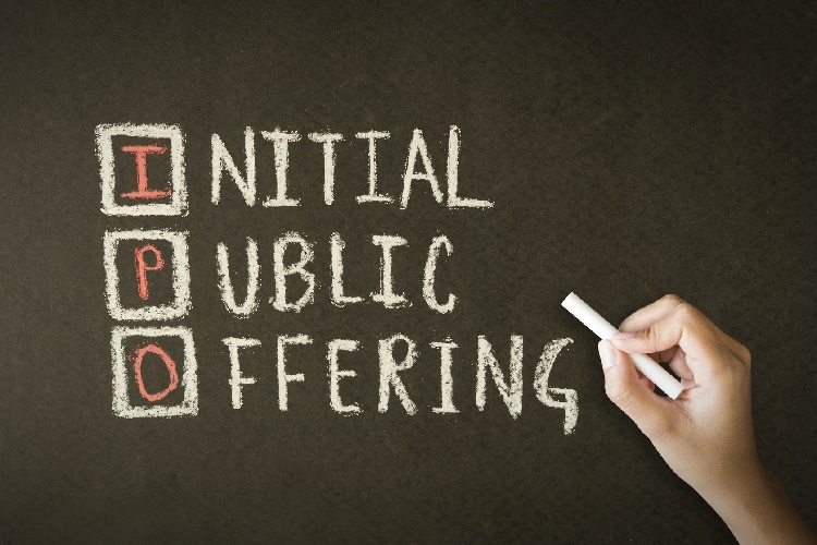 What is an IPO? Person drawing initial public offering on a chalkboard.